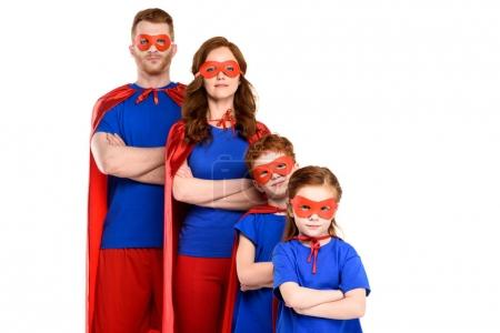 family of superheroes standing with crossed arms and looking at camera isolated on white