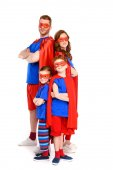 super family in costumes standing with crossed arms and looking at camera isolated on white