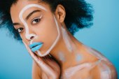 young african american woman with creative makeup isolated on blue