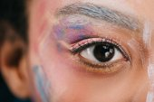 cropped shot of woman with colorful strokes on face