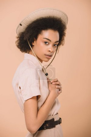 attractive african american woman in safari hat isolated on beige