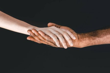 cropped image of african american boyfriend and girlfriend holding hands isolated on black