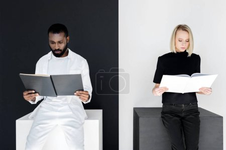 multicultural couple reading black and white books, yin yang concept
