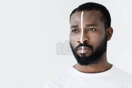 headshot of handsome african american man with white stripe on face isolated on white