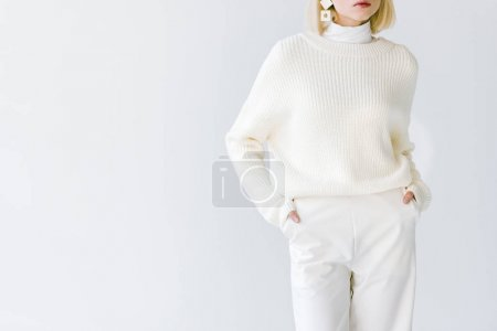 cropped image of stylish blonde woman in white clothes isolated on white