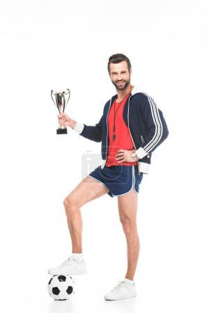 soccer trainer with trophy cup and ball, isolated on white