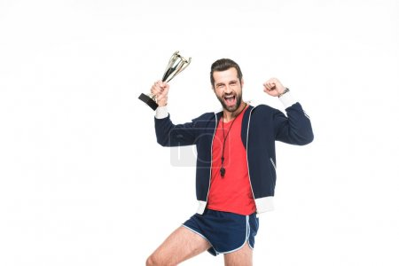 excited sportive trainer yelling and holding award, isolated on white