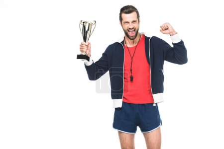 excited sportive trainer yelling and holding trophy cup, isolated on white