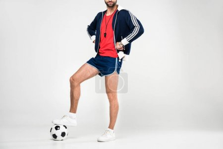 cropped view of soccer coach in sportswear and ball, isolated on white