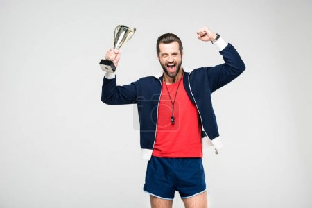excited sportive coach screaming and holding trophy cup, isolated on white