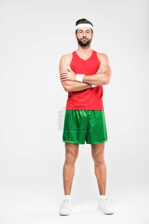 Photo for Sportsman posing in retro sportswear with crossed arms, isolated on white - Royalty Free Image