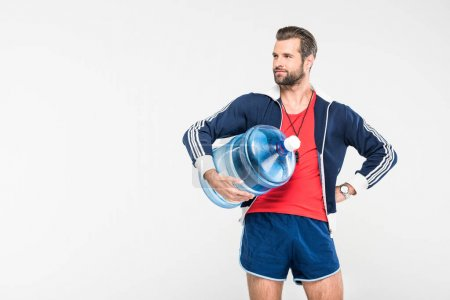 sportive trainer with big bottle of water, isolated on white