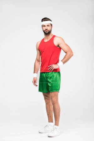 caucasian sportsman posing in retro sportswear, isolated on white