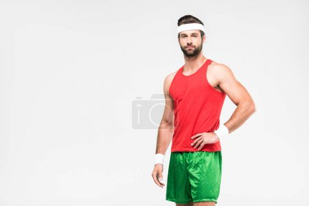 sportsman posing in retro sportswear, isolated on white