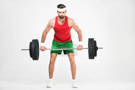 sportsman in retro sportswear training with barbell, isolated on white