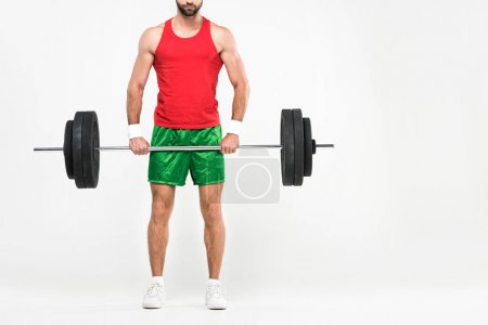 cropped view of sportsman in retro sportswear holding barbell, isolated on white