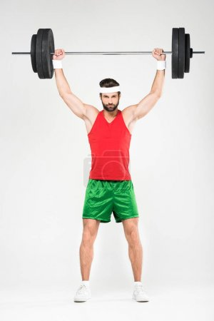 strong sportsman holding barbell, isolated on white