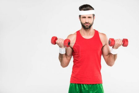 retro sportsman exercising with dumbbells, isolated on white