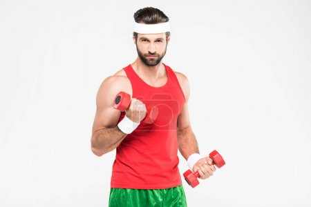 Photo for Sportsman in retro sportswear training with dumbbells, isolated on white - Royalty Free Image