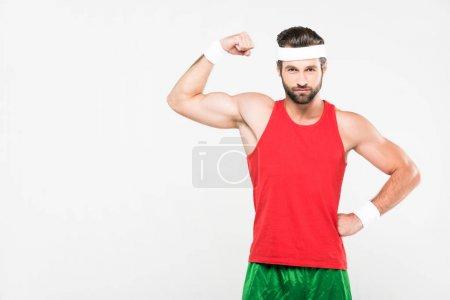 muscular sportsman posing in retro sportswear, isolated on white