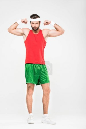 sportsman in retro sportswear showing muscles, isolated on white