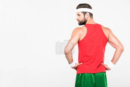 back view of sportsman posing in retro sportswear, isolated on white