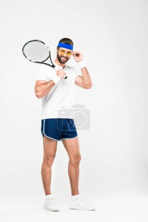 smiling tennis player in retro sunglasses with racket, isolated on white