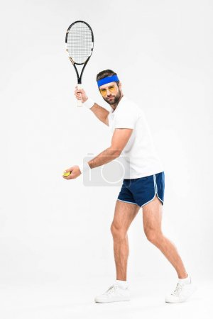 sportsman in retro sunglasses playing tennis with racket and ball, isolated on white