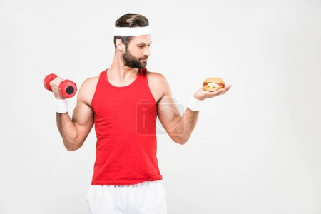 sportsman choosing junk food or sporty healthy lifestyle, isolated on white