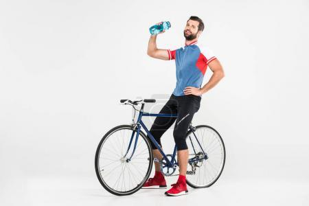 sportsman with bicycle holding sport bottle, isolated on white