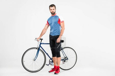 handsome sportsman with bike, isolated on white