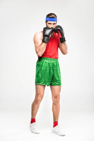 Photo for Retro sportsman exercising in boxing gloves, isolated on white - Royalty Free Image