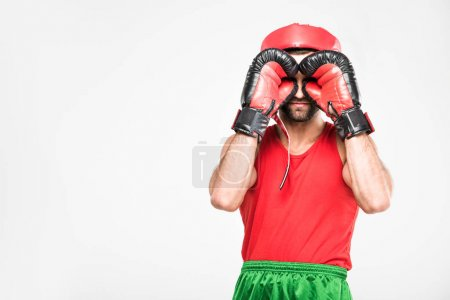 retro sportsman training in boxing gloves, isolated on white