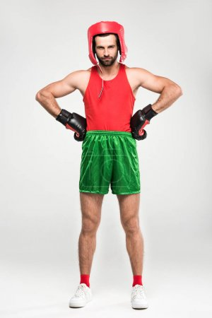 sportsman in retro helmet and boxing gloves, isolated on white