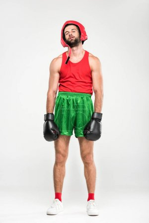 tired boxer in retro helmet and boxing gloves, isolated on white