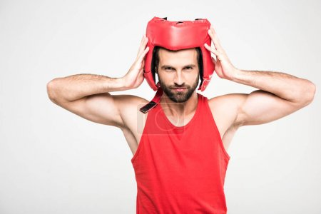 Photo for Bearded sportsman in red retro helmet, isolated on white - Royalty Free Image