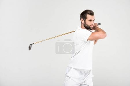 male golfer in white sportswear with golf club, isolated on grey