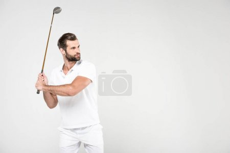 confused golf player in white sportswear with golf club, isolated on grey