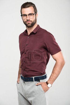 handsome bearded man posing in casual closing and eyeglasses, isolated on grey