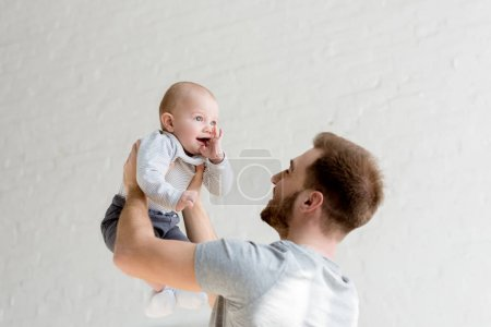 Photo for Father playing with little son at home - Royalty Free Image
