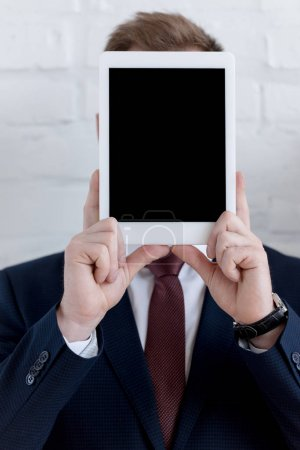 Photo for Businessman in formal wear holding digital tablet with blank screen - Royalty Free Image