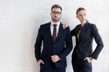 Photo for Confident business coworkers posing together near white wall - Royalty Free Image