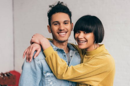 portrait of young smiling mixed race couple