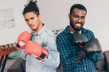 portrait of two young multicultural men in boxing gloves