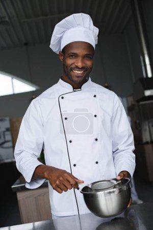handsome african american chef at restaurant kitchen