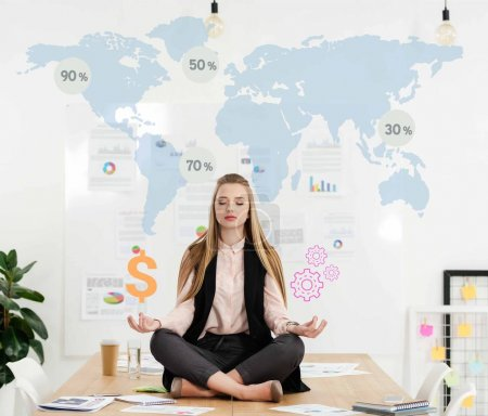 calm businesswoman meditating in lotus position on table in office with dollar sign and cogs in hands and world map on background