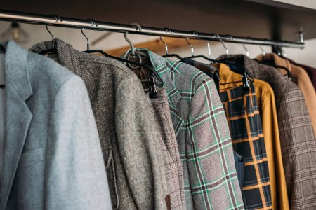 different jackets on hangers at sewing workshop