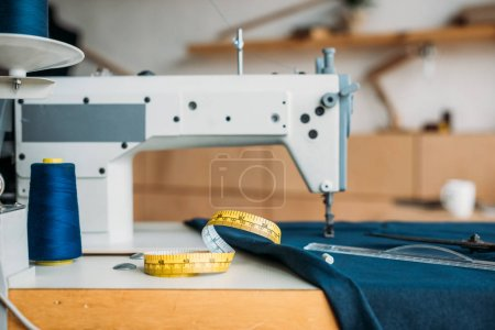 tape measure on sewing machine at sewing workshop