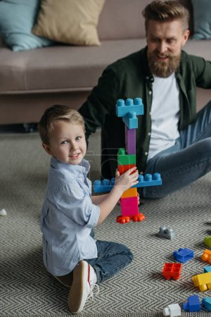 Photo for Family playing with colorful blocks together at home - Royalty Free Image