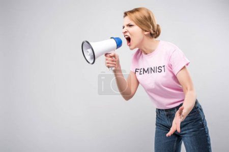 Woman in pink feminist t-shirt yelling at megaphon...